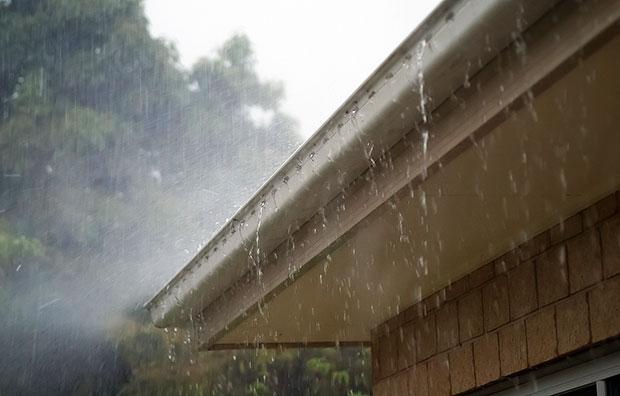 Rain Falling Into Roof Gutter